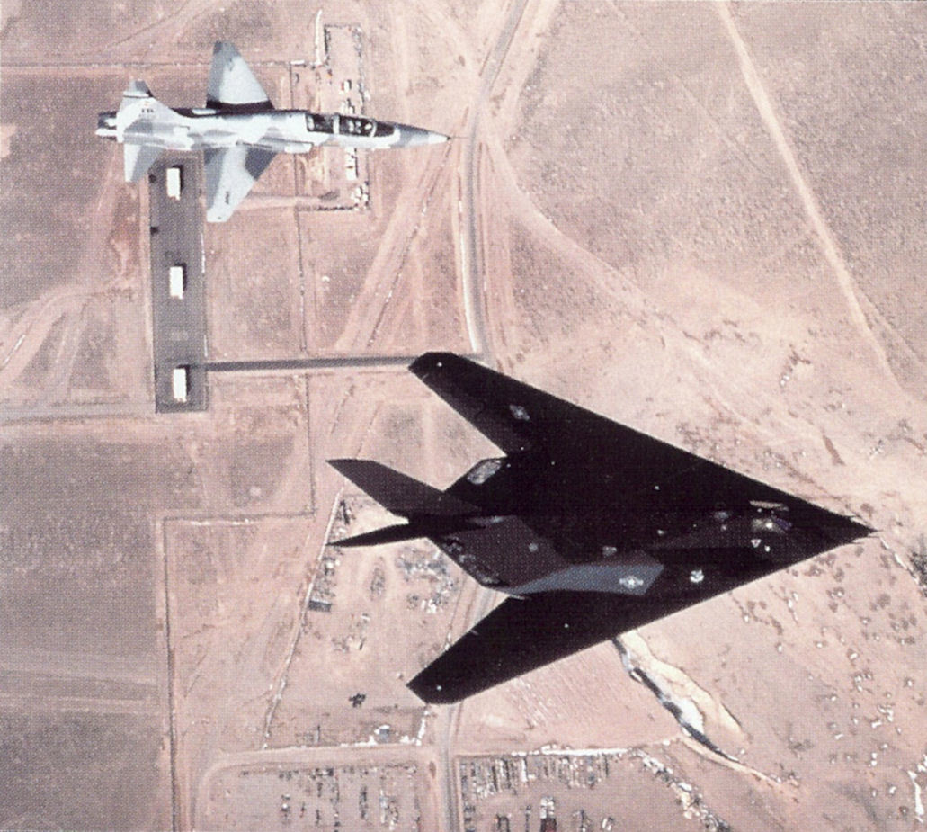 large.4450th_Tactical_Group_F-117_and_T-38_over_Tonopah_Test_Range_Airport.jpg